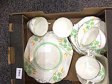 Part Teaset green and orange floral decoration on