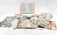 Large box of assorted packets of stamps withc cove
