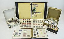 Mix of albums and boxes of mostly British stamps.