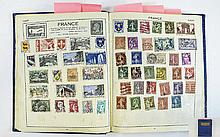 Blue Victory stamp album containing mix of old and