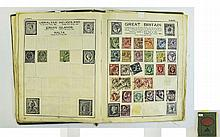 An old battered A5 Victory stamp album filled with