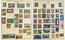 An excellent  Strand  stamp album. Well filled wit