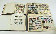 Stamp Albums Collection of four albums, two in har