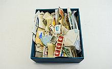 Box full of assorted stamps from all over the worl