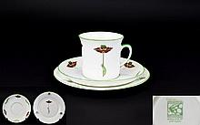 Foley Art China Peacock Pottery Art Nouveau Espresso Cup Three items in total to include cup, saucer and charger. White ground with stylised Art Nouveau poppy pattern with seedhead detail to rim, trimmed in spring green. Very good condition