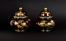 Carlton Ware Rouge Royale Pair of Lidded Squat Ovoid Vases ( 2 ) Decorated In Painted Enamels to Covers and Bodies. Patterns Include 1/ The Mikado Pattern. 2/ Peacock Pattern. Each 5 Inches High. Full Carlton Ware Marks to Underside. Both Mint