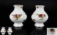 A Pair of Royal Albert Old Country Roses Bud Vases 5 inches in height.