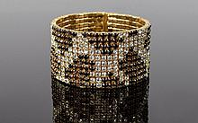 Black, White and Champagne Crystal Cuff Bracelet, in a 'snakeskin' pattern; the circular cuff holds it's shape when the opening, which is edge to edge, with no clasp, is opened to slip over the wrist