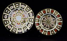Two Royal Crown Derby Plates Decorative plates in traditional Imari pattern with gilt trim. The first marked to base 1128. The second marked to base 2451.