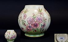 Moorcroft Contemporary Trial Vase on Bulbous Shape ' Spring Blossoms ' Pattern on Cream Ground. Date 12/10/89. Designer Sally Tuffin. Condition - Some Crazing to Body of Vase. Height 7 Inches.