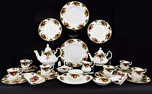 Royal Albert 'Old Country Roses' Coffee and Tea Set over (106) in total. Comprises 11 dinner plates, coffee pot, teapot, swan figure, 17 cups, saucers and side plates, sandwich plate, serviettes, 12 dessert bowl, 5 fluted dishes, a cake stand missing