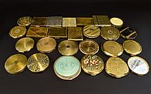 A Large And Varied Collection Of Vintage Compacts (25) in total to include several Kigu compacts, gold tone machine etched compacts, several rectangular examples, mint green enamel 1950's compact etc. Please see accompanying images.