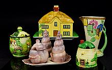 A Collection Novelty Ceramics And Carltonware Eight items in total to include 1960's four piece Carlton Ware cruet set comprising salt, pepper and mustard pot in the from of seashells on scallop shell tray. Large butter dish in the form of a thatched