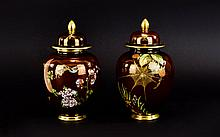 Carlton Ware Rouge Royale Pair of Lidded Ovoid Vases, Decorated In Painted Enamels to Covers and Bodies. Comprises 1/ Spiders Web Pattern. 2/ Bird of Paradise Pattern. Full Carlton Ware Marks to Undersides. Each 7.5 Inches High. Both In Mint