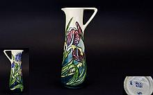 Moorcroft - Ltd Edition / Numbered M.C.C - Members Only Tube lined Ewer / Jug ' Blue Iris Pattern ' Designer Rachel Bishop. Date 1997. 250 Pieces Produced Only. Height 9.5 Inches.