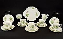 Royal Albert Part Teaset  'Friendship' series, Designer 'Hawthorne' comprising 6 cups, saucers and side plates, sugar bowl and milk jug. Decorated in pink and green decoration on white ground.