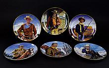 Franklin Mint Heirloom John Wayne -Symbol of America Collection Limited Edition Set of Porcelain Collector Plates. (6) in total. All with certificates of authenticity certifying that they bear an original work of art by Robert Tanenbaum and bear the