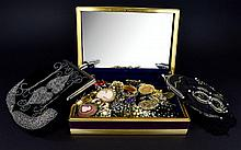 A Jewellery Box Containing A Large Collection Of Brooches Purple velvet hin