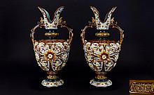 Majolica - Pair of Fine and Impressive Wilhelm Schiller & Son Pair of Urn Shaped Vases. c.1890's. Decorated with Fish Head Handles and Painted Enamel Floral Decoration. Each 14.5 Inches Tall.