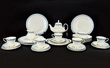 Royal Doulton Lorraine Flatware Service Thirtyfour items in total to include sandwich plate, 6 dinner plates, 6 bowls, 6 cups with matching saucers, sugar bowl etc. White ground trimmed with silver, the rims decorated in pale blue dot and trefoil