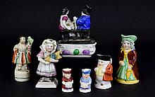 A Collection Of 19th/Early 20th Century Staffordshire Miniature Figures Seven in total to include pillbox with figurative lid, small flatback in the form of young girl, small girl in bonnet. Also four miniature character jugs. Please see accompanying
