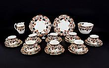 Staffordshire Part Teaset comprising 8 cups, saucers and side plates, a large sugar bowl and milk jug and two sandwich/cake plate.