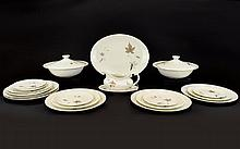 English Translucent China Tumbling Leaves Royal Doulton Part Tea Set Brown. Compromising of one gravy jug with plate, two casserole dishes, one large oval plate, six small plates, six side plates and six dinner plates. Total of 23 pieces.