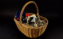 A Basket Containing A Large Quantity Of Mixed Costume Jewellery Wicker basket with a varied collection of watches, earrings, beaded necklaces, brooches, pendants and findings etc.