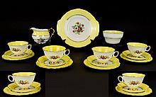 Regency Bone China Part Tea Set. Comprising six cups, saucers and side plates, sugar bowl and milk jug. Bright yellow decoration with floral bouquets to white ground with gilt trim.