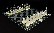 Modern Glass Chess Set Comprising of glass board and frosted and clear glass pieces.
