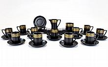 Portmeirion Pottery Part Coffee Service, designed by Susan Williams - Ellis, matt black with wide gilt tone key border (49 ) pieces in total. To include milk jug, coffee cups, sugar bowl etc