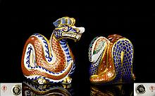 Royal Crown Derby Figural Paperweights ( 2 ) Two In Total. Comprises 1/ Dragon - Chinese Year of The Dragon. Issued 1988 - 1992, Silver Stopper. 1st Quality & Mint Condition. 2/ Snake - Head of a Cobra, Pattern In Red, Blue, Gold and Jade Green.