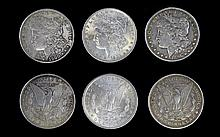 United States of America Silver Morgan One Dollars ( 3 ) Three High Grade Coins In Total. Dates and Mint Issue. 1/ 1896 Philadelphia. 2/ 1883 New Orleans. 3/ 1900 Philadelphia - Please See Photo.