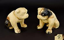 A Pair Of Vintage Ceramic Bulldog Figures Two unglazed earthenware figures in the form of seated Bulldogs, each painted with black and brown brush marks on buff ground. Each 5 inches in height, good condition