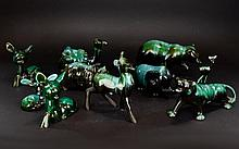 A Collection Of Green/Black Blue Mountain Ceramic Figures comprising of five wildlife animals, five deer's and one camel.