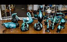 A Collection Of Green/Black Blue Mountain Bird Ceramic Figures comprising of six ducks and six swans. The largest being 12inch x 5inch.