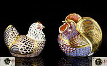 Royal Crown Derby Paperweights ( 2 ) Two In Total. Comprises 1/ ' Cockerel ' Introduced In 1992, To Compliment The Chicken, Highly Decorated with Intricate Feather Design In Cobalt Blue, Pale Blue, Read and Gold with Gold Stopper 1st Quality & Mint