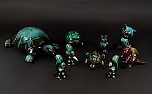 A Collection Of Green/Black Blue Mountain Animal Ceramic Figures comprising of three tortoises, three squirrels, two cats and one otter.