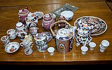 A Large Collection Of Decorative Oriental Ceramics Over thirty items in total to include several ginger jars, biscuit barrel, Foo dog, teapot, Sake cups, Buddha figure etc.