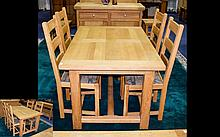 A Solid Oak Dining Suite Contemporary dining suite comprising extending table and four chairs of plain form. Chairs upholstered in illuminated manuscript design jacquard fabric. Very good condition. Table height, 29 inches, width 53 inches, depth 36