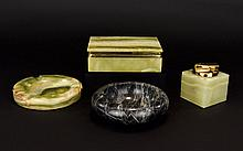 A Collection Of Onyx Smoking Accessories Four items in total to include green onyx cigarette box, Ronson table lighter and two carved ashtrays.