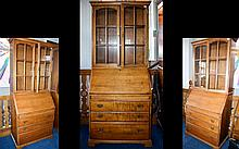 'Younger Furniture' Sectional Glazed Bureau .Comprising three bottom drawers, lockable pull down writing slope and glazed two shelf cabinet to top. 76 inches high, 32.5 inches wide and 16.5 inches deep.