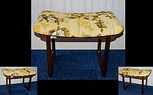 Mid Century Modern Footstool, teak wood frame of plain form with upholstered Japanese top finished in yellow and taupe padded fabric. 156 inches high 23 inches wide and 17.5 inches deep.