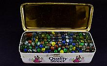 Tin of old vintage marbles