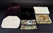 A Collection Of Vintage Bags Six in total to include two 1960's iridescent beaded evening bags with seed bead and sequin detail, small modern tapestry purse, 1980's black velvet envelope bag with tassel and rosette detail. Also, a 1950's faux suede