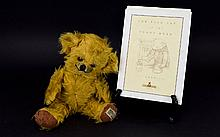 A Vintage Jointed Cheeky Bear By Merrythought 1950's jointed mohair teddy bear by British brand 'Merrythought' complete with amber glass eyes, hand stitched 'cheeky' grin, felt paw pads and bell concealed in each ear. Original label to foot reads