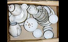A Oriental Part Tea Service approx 23 pieces with a Japanese garden scene.