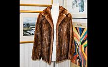 Medium Brown Short Mink Jacket with rever collar and slit pockets. Fully lined.