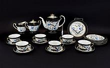 Oriental 'Lucky' Moriage Dragonware Japanese Teaset comprising coffee pot, sugar bowl, milk jug and 6 cups and saucers. White ground with dragon decoration.(one plate has a chip).