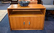 A 1970's Low Sideboard By Gibbs Teak bookshelf/sideboard of plain form with double doors to bottom. Good condition